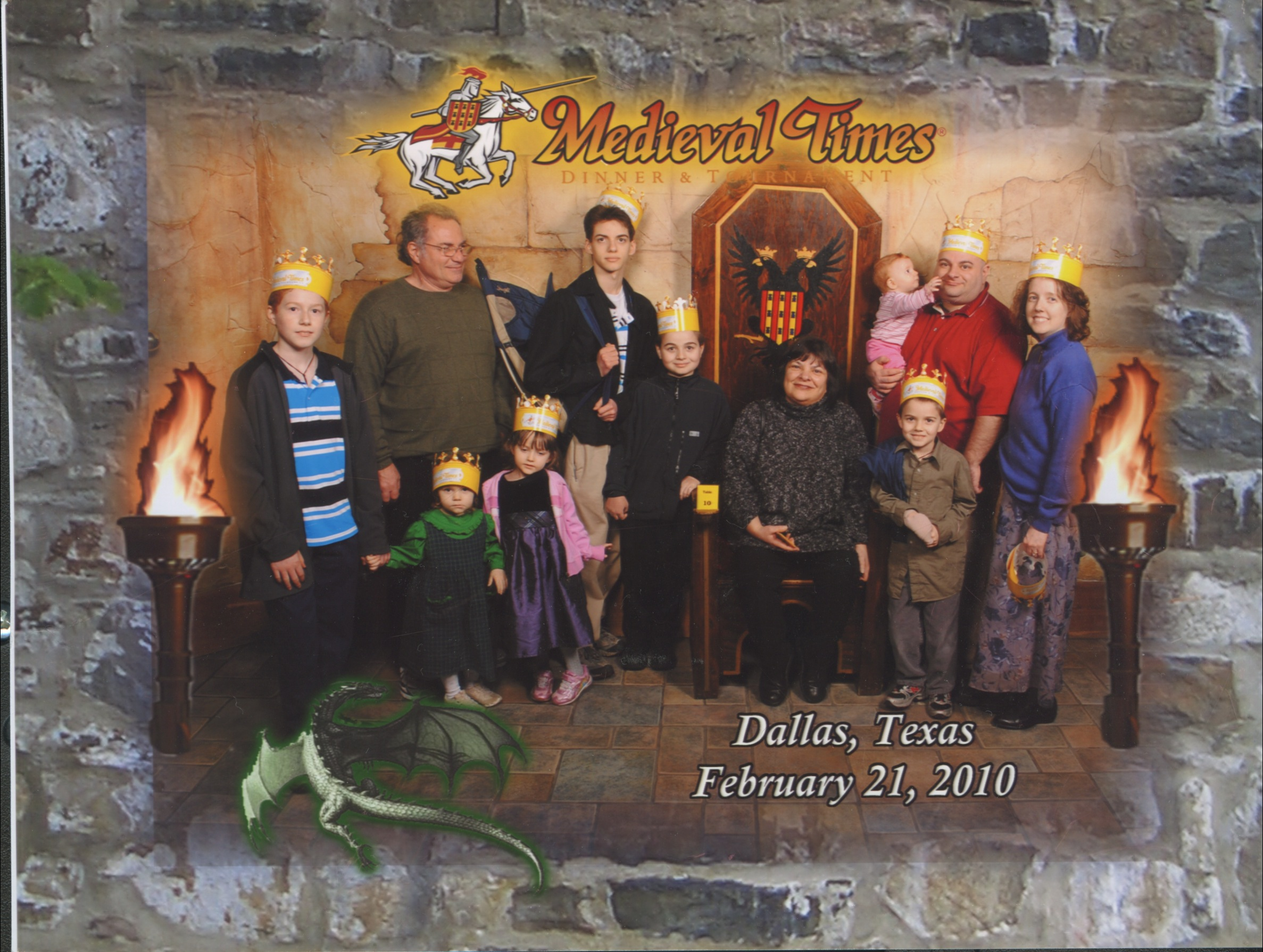 Medieval Times Throne Room. Michael, Grandfather 'Nunu', Bernie Jacinta, Joseph, Nunzio, Grandmother 'Nana' sitting on a throne, Justin holding Catie, Cross and Jen. Bottom Text: 'Dallas, Texas February 21, 2010'