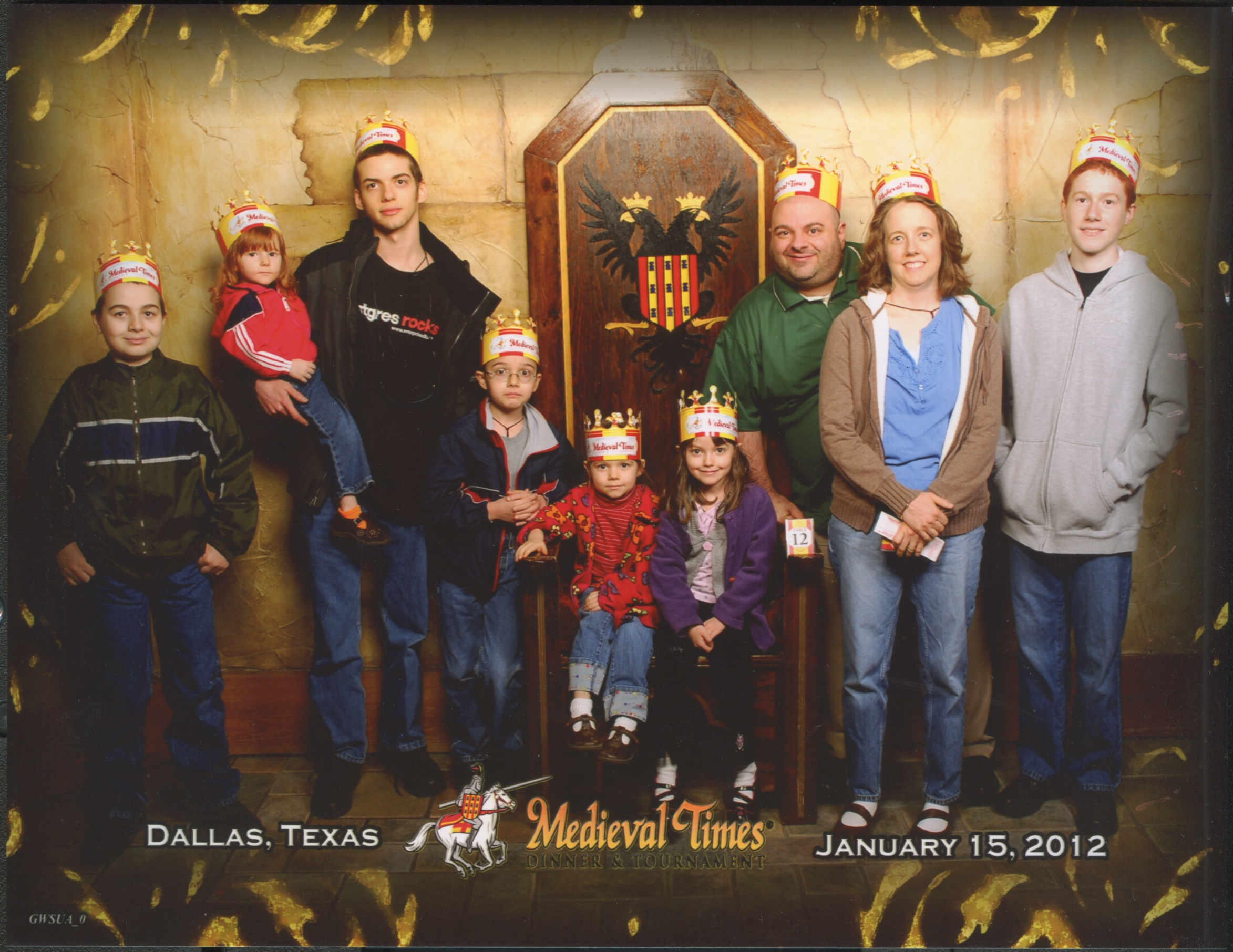 Medieval Times Throne Room. Nunzio, Joseph holding Catie, Cross, Bernie, Jacinta, Justin, Jen and Michael. Bottom Text: 'Dallas, Texas January 15, 2012'