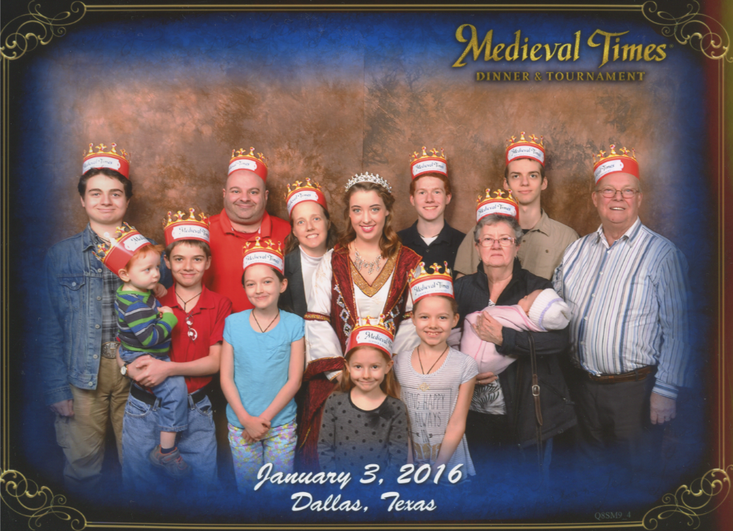 Medieval Times Stone Wall Background. Nunzio, Cross holding Becket, Papa, Jacinta, Jen, The Princess, Catie, Bernie, Michael, Grandmother 'Nana' holding Caterina, Joseph and Grandfather 'Pepere'. Bottom Text: 'Dallas, Texas January 3, 2016'