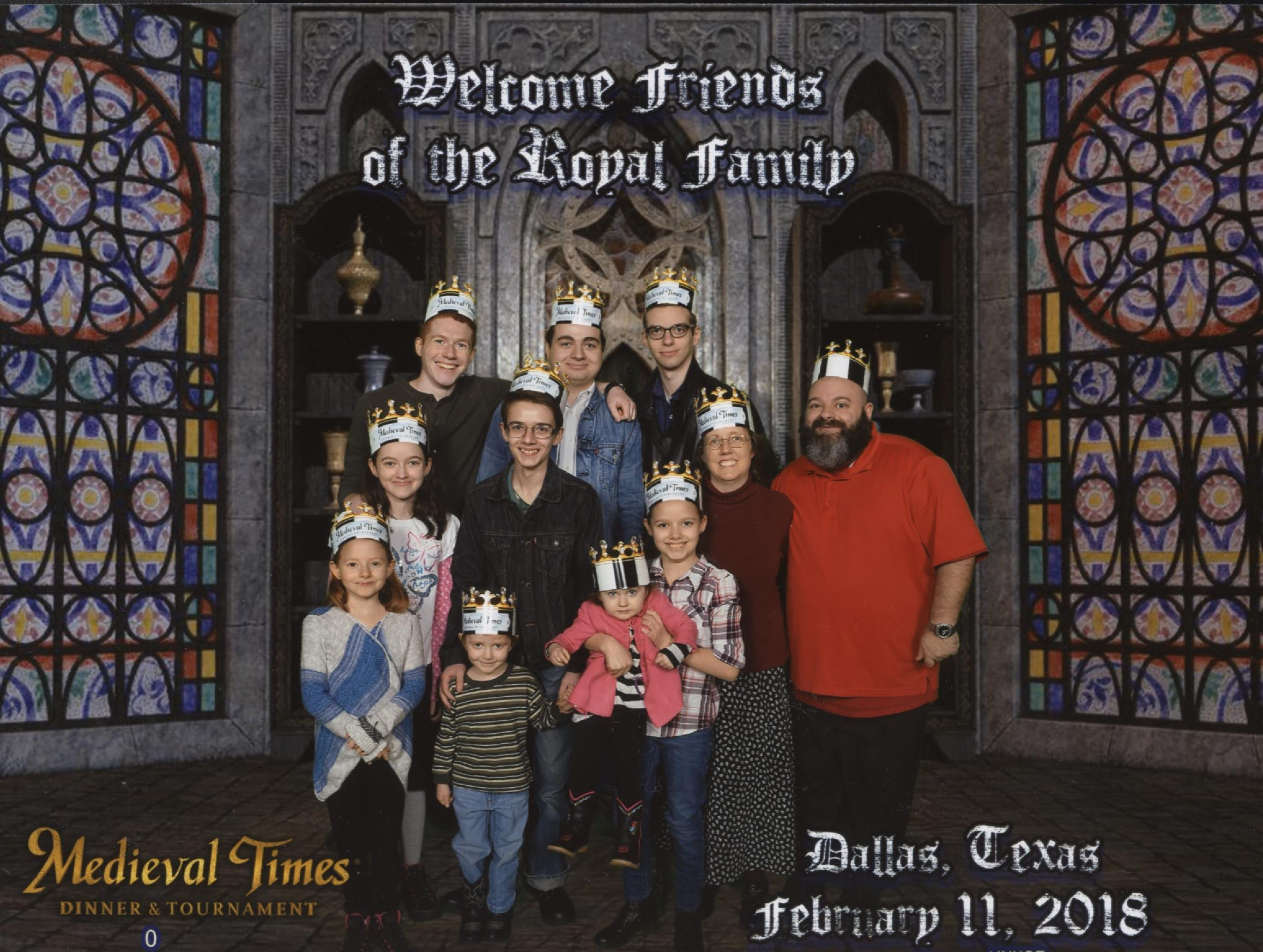 Medieval Times Stained Glass Windows Background. Top Text: 'Welcome friends of the Royal family.' Catie, Jacinta, Michael, Becket, Cross, Nunzio, Bernie holding Cecilia, Joseph, Nunzio, Jen and Justin! Bottom Text: 'Dallas, Texas February 11, 2018'